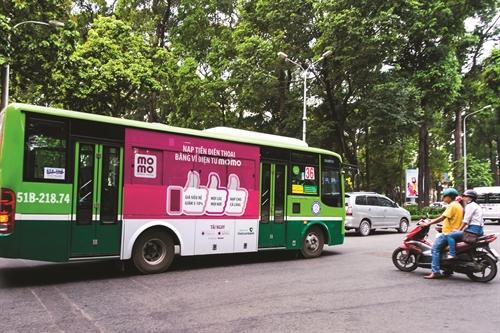 Quang cao xe buyt: Sau thi diem se tang diem