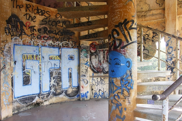 Stairs and walls inside the park are covered with graffiti.