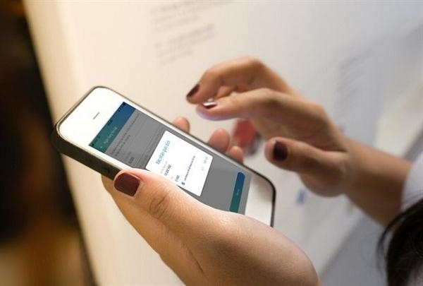 """Tất cả các quốc gia cho phép Mobile Money đều tạo ra tăng trưởng kinh tế tới 0,5%"""", Bộ trưởng Nguyễn Mạnh Hùng chia sẻ. Ảnh: tiendientu.org"""