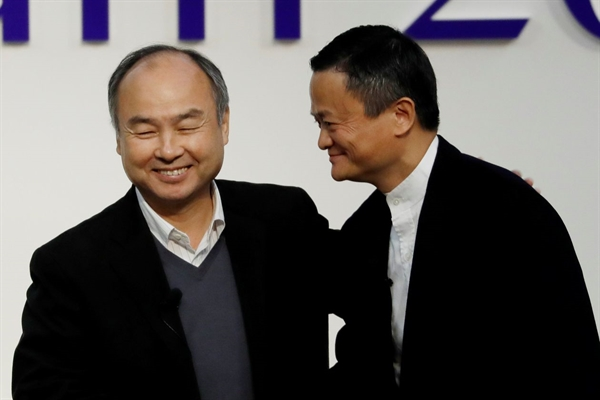 Masayoshi Son, left, and Jack Ma in Tokyo late last year. PHOTO: KIM KYUNG-HOON/REUTERS
