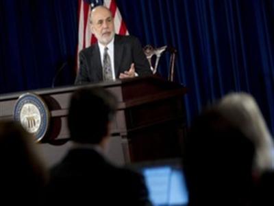 Fed tiếp tục cắt giảm QE
