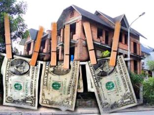 Sàn giao dịch bất động sản phải lập báo cáo chống rửa tiền