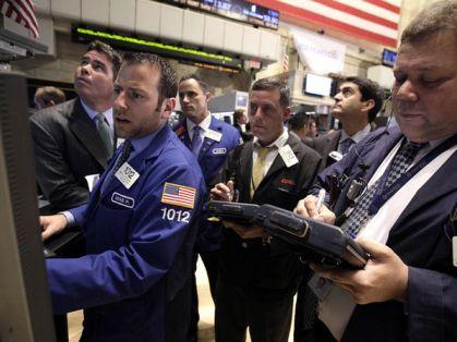 Chứng khoán Mỹ đồng loạt tăng do trông đợi gói kích thích từ Fed