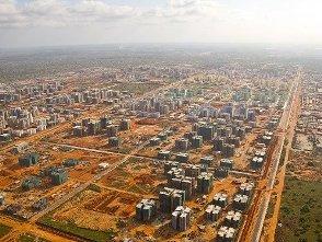 """Trung Quốc xuất khẩu """"thành phố ma"""" sang Angola"""