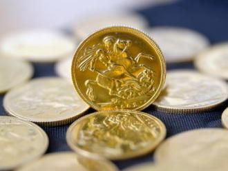 Giá vàng giao ngay tại châu Á giảm xuống 1.580 USD/ounce