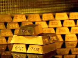 Vàng giảm còn 1.590 USD/oz sau tuyên bố của ECB