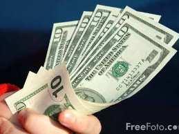 Nhà đầu tư giảm đặt cược USD tăng giá