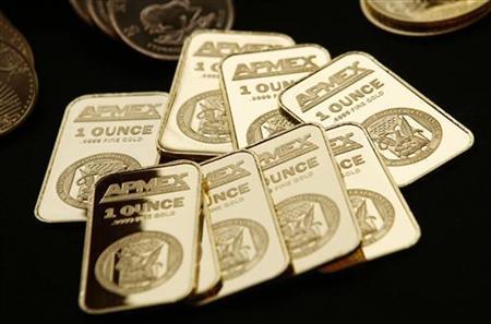 Vàng sụt mạnh xuống 1.720 USD/oz do bán tháo
