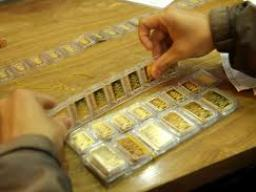 Giá vàng giảm gần 700 nghìn đồng/lượng trong tháng 1