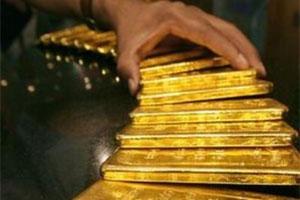 Vàng vững giá trên 1.605 USD/oz trước cuộc họp Fed