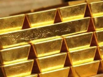 Vàng chạm 1.600 USD/oz sau số liệu sản xuất Mỹ