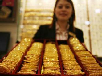 Giá vàng lao dốc xuống sát 1.260 USD/oz