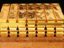 Giá vàng châu Á rơi tự do xuống dưới 1.290 USD/oz