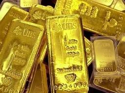 Giá vàng giảm tiếp xuống 1.326,8 USD/oz