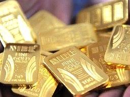 Giá vàng giảm 5 phiên liên tiếp xuống sát 1.302 USD/oz