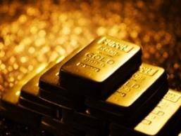 Tâm lý thận trọng của giới đầu tư giữ giá vàng giảm nhẹ xuống 1.386,5 USD/oz
