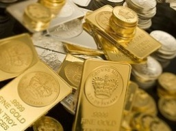 Giá vàng lao dốc trước dự báo Fed giảm kích thích trong tháng 10