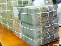 Fitch: Xếp hạng rủi ro của ngân hàng Việt Nam bị ảnh hưởng do chậm cải cách