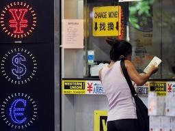 Hong Kong nên cân nhắc neo tỷ giá với nhân dân tệ