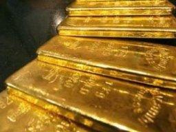 Giá vàng thế giới đột ngột tăng vọt lên 1.320 USD/oz