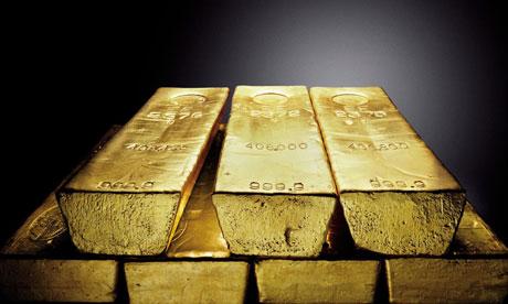 Giá vàng giảm xuống dưới 1300 USD/oz