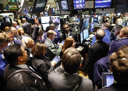 Chứng khoán Mỹ giảm trước khi Fed đưa ra quyết định về QE