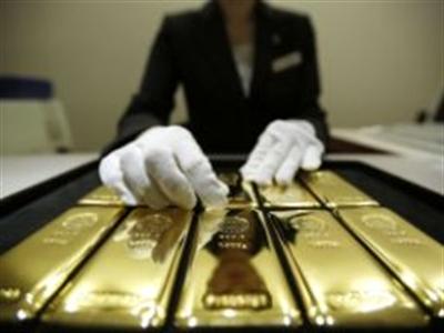 Vàng tăng vượt 1.315 USD/ounce sau biên bản họp Fed