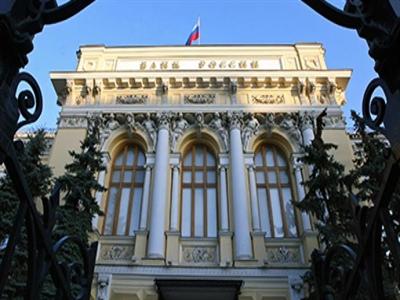 Nga tăng lãi suất để bảo vệ rúp sau khi bị hạ tín nhiệm