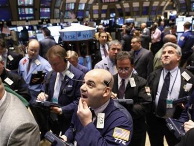 Chứng khoán Mỹ biến động mạnh sau phiên điều trần của Fed