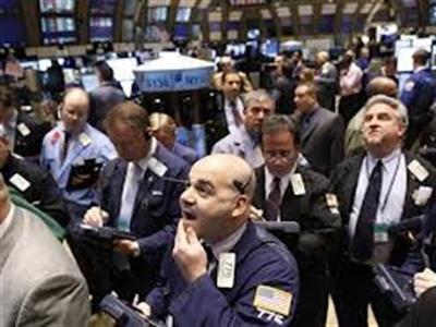 Chứng khoán Mỹ tăng mạnh nhất năm 2014 sau biên bản của Fed
