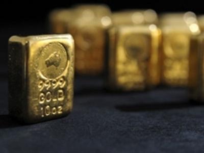 Dầu mất giá đang kéo giảm giá vàng