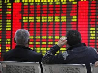 Chứng khoán châu Á giảm nhẹ nhưng vẫn cao nhất gần 7 năm