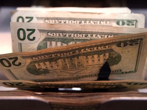 IMF: USD tăng, dầu mất giá chi phối tăng trưởng kinh tế toàn cầu