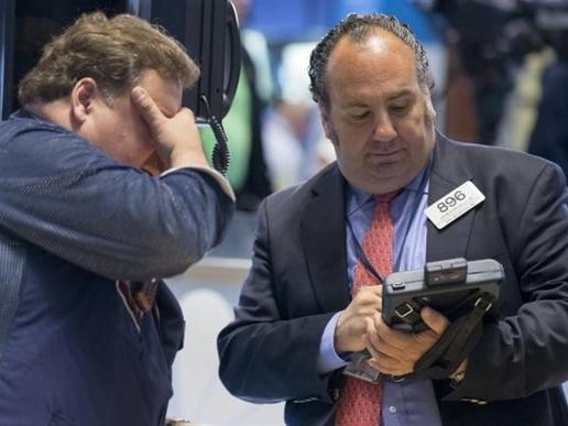 Chứng khoán Mỹ giảm, chờ giải pháp về Hy Lạp