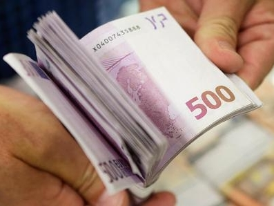 Euro giảm, chờ thỏa thuận cứu trợ Hy Lạp