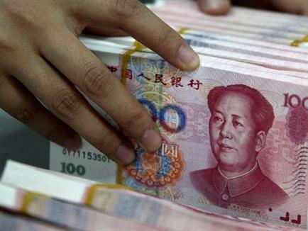 Trung Quốc bất ngờ hạ lãi suất, bỏ trần lãi suất huy động