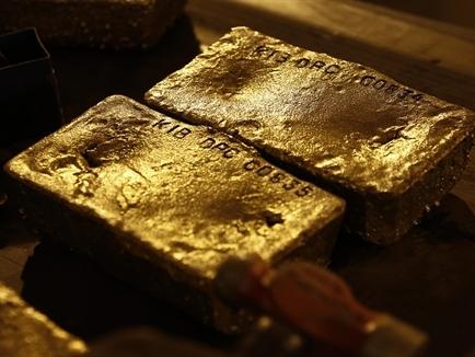 Giới đầu tư lạc quan về giá vàng tuần tới do đồn đoán tăng QE
