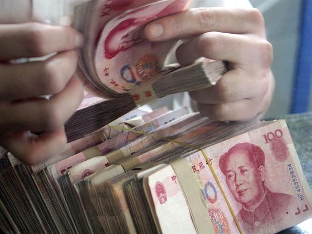 Nhân dân tệ suy yếu khi PBOC hạ tỷ giá mạnh nhất 6 tuần
