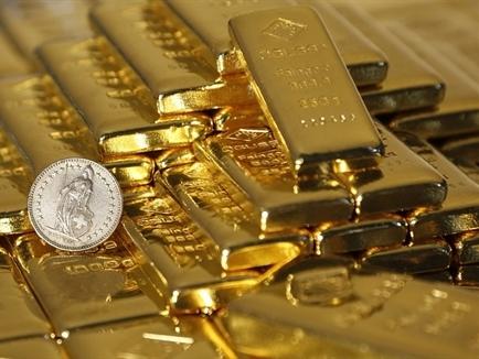 Giá vàng giảm do USD và chứng khoán mạnh lên