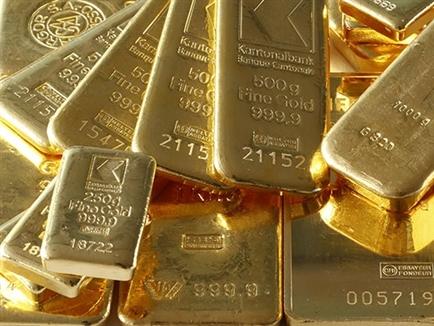 Giá vàng lên sát mức cao nhất 13 tháng do USD suy yếu