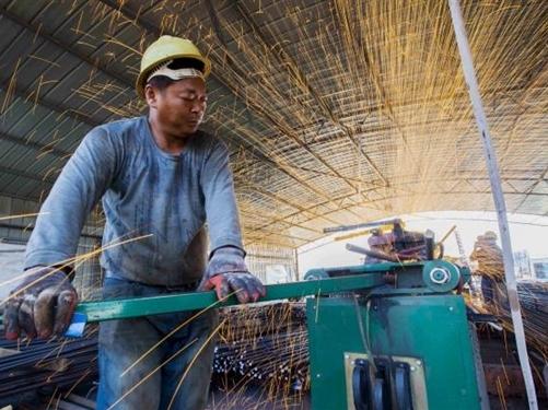 ADB hạ dự báo tăng trưởng kinh tế Trung Quốc 2016