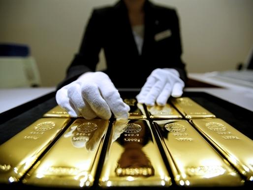 Giá vàng bắt đáy 2 tuần do USD mạnh lên