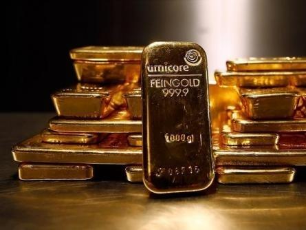 Giá vàng bắt đáy 3 tháng rưỡi do USD mạnh lên