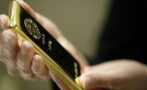 Giá vàng xuống thấp nhất 4 tuần khi USD tăng