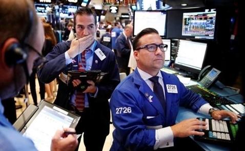 Chứng khoán Mỹ giảm sau bình luận của các quan chức Fed