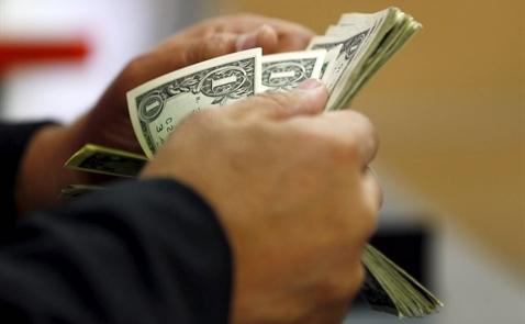 USD lên cao nhất 2 tuần do đồn đoán Fed sớm nâng lãi suất