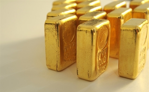 Giá vàng giảm khi số liệu sản xuất Mỹ đẩy tăng USD