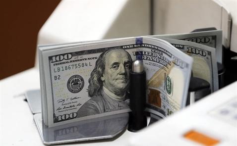 USD rơi khỏi đỉnh 7 tháng sau số liệu kinh tế của Trung Quốc