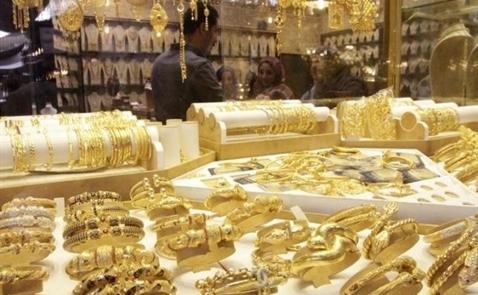 Giá vàng tăng khi USD, chứng khoáng đi xuống