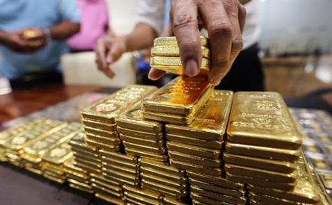 Giá vàng tiếp tục giảm khi Fed sẵn sàng nâng lãi suất